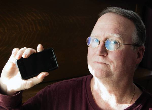 Howard Wood, of Downers Grove, was double-charged on his bill for one month by Virgin Mobile. A company spokeswoman said a glitch led to his cellphone service being cut off.