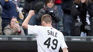 A more polished Chris Sale and a promising Tyler Flowers warmed the spirits of a chilled sellout crowd trying to rid itself of the White Sox's frustrating finish seven months ago.