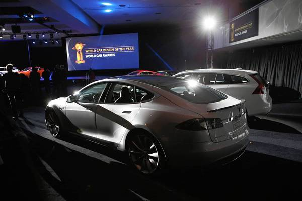 Tesla sold about 4,750 of its electric Model S sedans in the first quarter, beating expectations. Above, a Model S is displayed at the New York Auto Show last week after winning a green car of the year award.