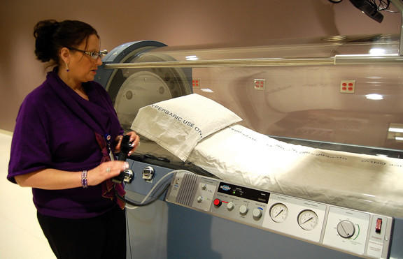 Beth Lopez demonstrates aspects of a new hyperbaric oxygen chamber at Fulton County (Pa.) Medical Center. Lopez is director of the hospital's new Wound Care Services Center.