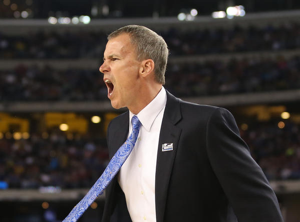 Florida Gulf Coast coach Andy Enfield reacts during the first half of the game against Florida.