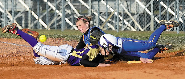 Smithsburg's Brooke Parks, left, and Clear Spring's Jenna Knable collide at first base during a pickoff attempt in Monday's game.