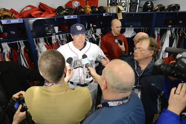 The IronPigs' Darin Ruf is surrounded by reporters and photographers at Media Day held at Coca-Cola Park on Monday.
