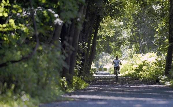 A cyclist rides the D&L Trail near Slatington.