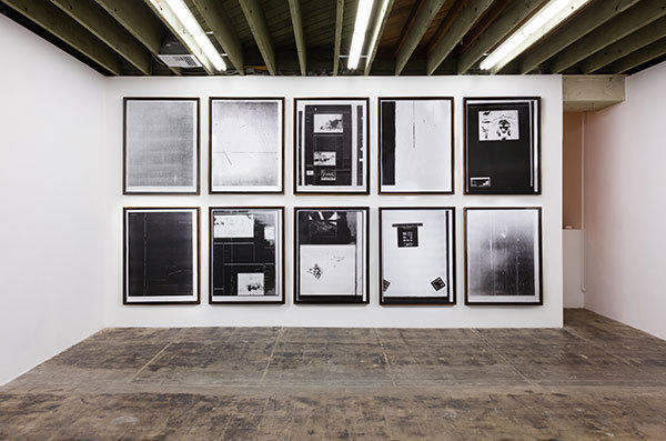 "Erlea Maneros Zabala's ""Past Work"" exhibition features a wall of large photocopied images produced by microfilm machines."