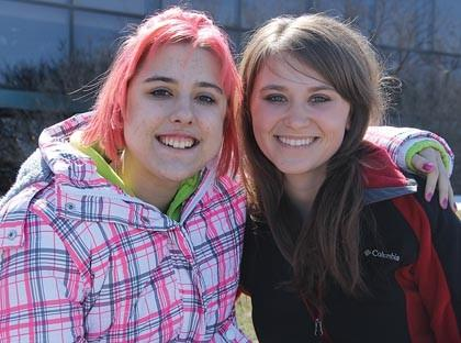 Tasha Imberi, left, of Eureka was diagnosed with a rare form of ovarian cancer and is now undergoing chemotherapy treatments in Aberdeen. Her friend, Nicole Rau, helped her dye her hair pink after she cut it to donate it to Locks of Love and brought Tasha to her most recent chemotherapy appointment.