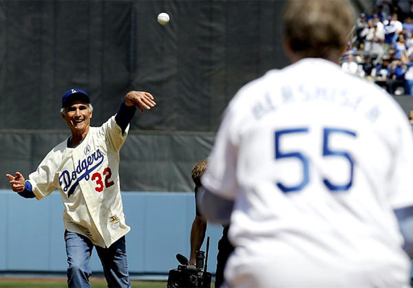 Dodgers legend Sandy Koufax throws out the first pitch on opening day against the San Francisco Giants.