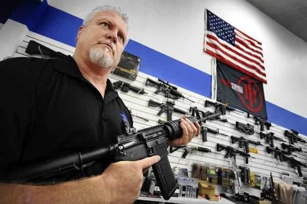 Jeff Dillard, C.O.O. of National Armory, a major gun store in North Broward holds a National Amrmory Bear, which is a semi-automatic fully military specification rifle that fires a .223 or .556 round. Diillard says that many guns are selling out faster than they can be re-stocked.