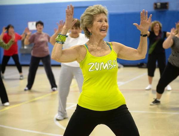 Grace Conti, of Orefield, 70-year-old Zumba instructor, leads a class at Kratzer Elementary in South Whitehall Township. MICHAEL KUBEL The Morning Call Wedesday March 20, 2013