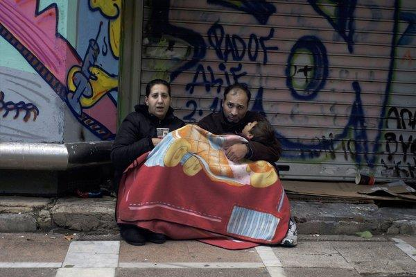 A family begs at Stadiou Street in Athens. The number of homeless in Athens is rising rapidly since 2009 as Greece struggles to deal with its debt crisis.