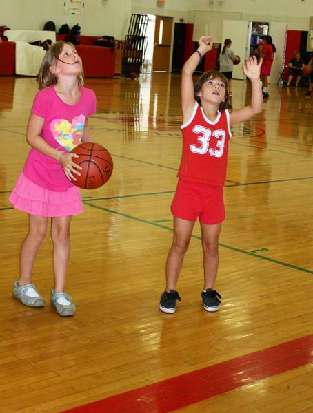 Two girls play basketball as part of the Girls Play Strong program at the Park District of Highland Park.