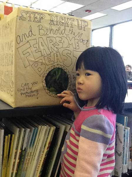 Amy Yoon, 3, is exploring one of the interactive exhibits the Northbrook Public Library set up on April 1 as part of its National Poetry Month celebration.