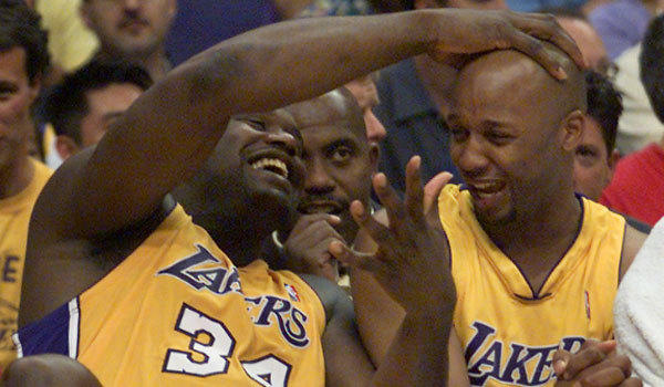 Shaquille O'Neal, left, and Brian Shaw enjoy the moment as the Lakers complete a sweep of the San Antonio Spurs in the 2001 Western Conference finals.