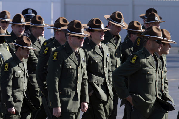 Illinois State troopers arrive for the funeral of Illinois State trooper James Sauter, killed in a highway crash on March 28.