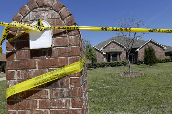 The scene outside the home of Kaufman County, Texas, Dist. Atty. Mike McLelland near Forney, Texas, where he and his wife were found shot to death.