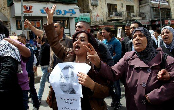 Palestinians take part a protest in the West Bank city of Nablus on Tuesday after the news of the death of Maysara abu Hamdieh in the Israeli Soroka hospital.