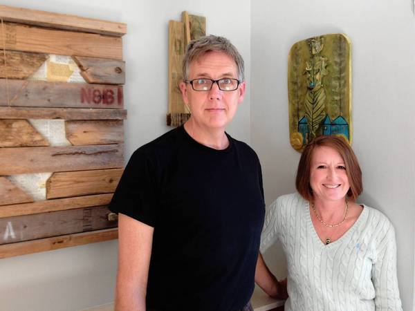 Richard Reep and Kimberly Mathis display some of their art in their Winter Park home. It will also be exhibited at Stardust Video and Coffee during the month of April.
