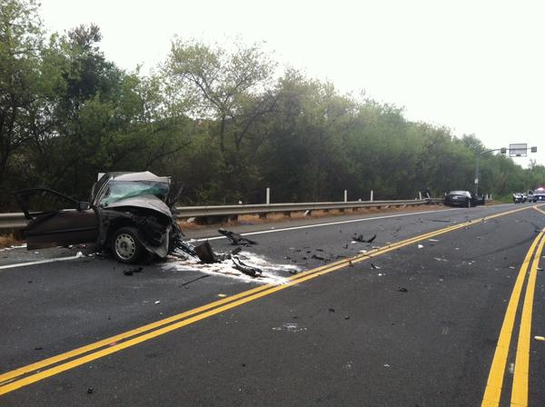 Wreckage is scattered along a stretch of Laguna Canyon Road after an accident early Tuesday.