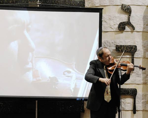 "Yosef Yankelev performs ""Ravel's Kaddish"" during last year's Yom Hashoah program at Temple Beth Am in Margate."