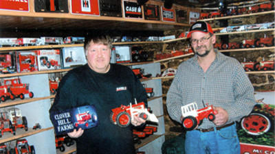 """David W. Paul, left, and Michael A. Walker display farm toys for Hillcrest Grange's March 13 program, which was """"Toys for All Ages."""" Forty years ago in 1973 both men displayed favorite farm toys for two special displays while they attended elementary schools."""