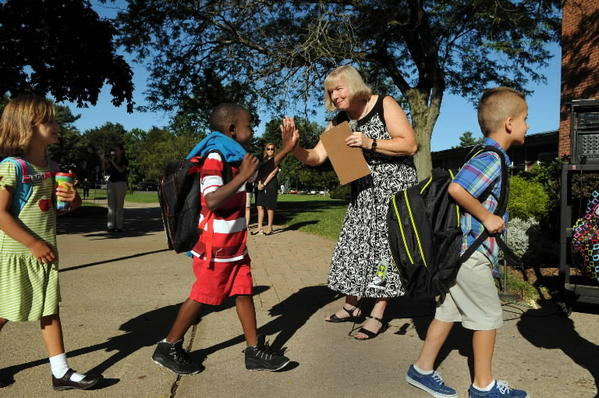 In this Aug. 29, 2012 photo, Duffy Elementary School Principal Kathleen Tracy greets students on the first day of school. Tracy is stepping down at the end of this year. Dr. Karen Fitzsimmons, principal of Memorial Elementary School in East Hampton, will take her place.
