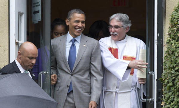 President Obama exits St. John's Episcopal Church with the Rev. Luis Leon after he and the first family attended Easter services in Washington, D.C.