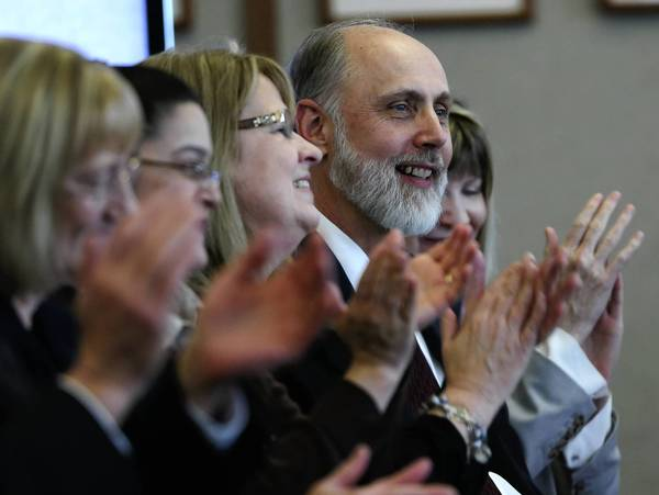 Dr. Douglas D. Baker, second from right, is introduced as new Northern Illinois University president in DeKalb, Illinois