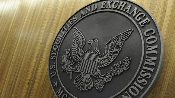 The Securities and Exchange Commission seal is seen at the agency's Washington, D.C., headquarters in a 2011 file photo.