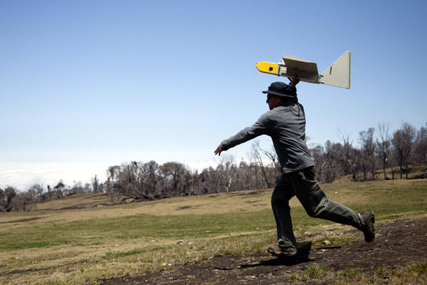 NASA research scientist Rick Kolyer launches a Dragon Eye drone.