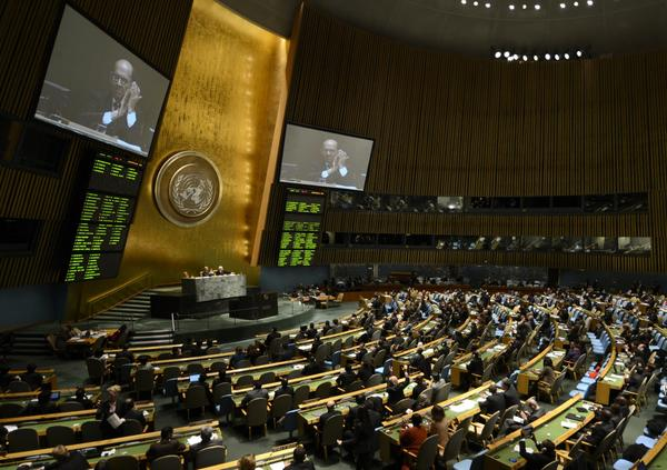Delegates to the United Nations General Assembly applaud the passage of the first U.N. treaty regulating the international arms trade on Tuesday.