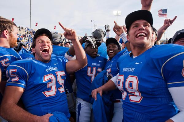 Tulsa Hurricanes players react after winning the CUSA Championship in 2012.
