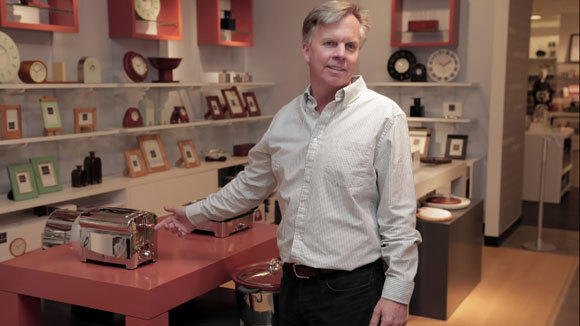 J.C. Penney CEO Ron Johnson shows a bread-shaped Michael Graves toaster at a Dallas store in February.