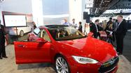 Tesla Motors has worked out a deal with several banks to sell its pricey electric sports sedan with a guaranteed buyback after 36 months.