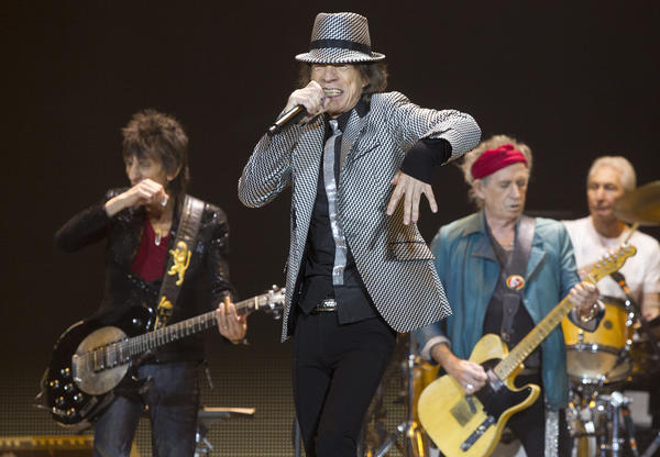 Mick Jagger, center, Keith Richards, Ronnie Wood, left, and Charlie Watts, right, of the Rolling Stones perform in London. The Rolling Stones will return to the road for a 2013 tour.