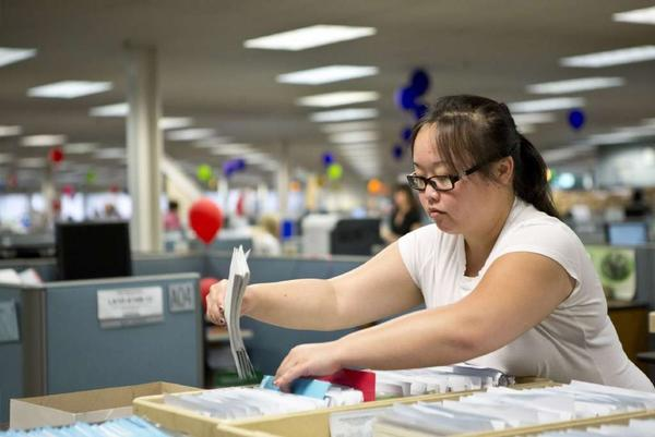 Individual incomes in 2011 as reflected on state returns rose 2.2% to $34,684 compared with 2010, while joint returns rose 3.6% to $68,122, according to the California Franchise Tax Board. Above, a worker sorts through California income tax checks and returns last year.