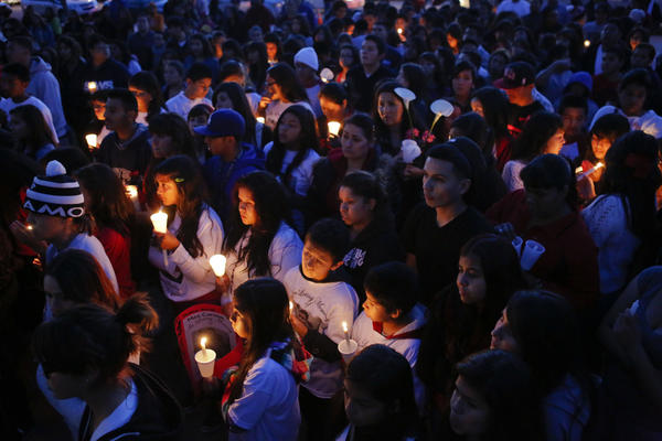 Friends and classmates of 13-year-old Angela Sandoval hold a candlelight vigil at Eastmont Intermediate School on Monday, in Montebello. Sandoval was one of five killed in a Nevada crash.