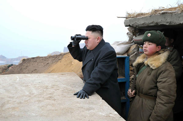 North Korea's state-run media have been casting novice leader Kim Jong Un, left, as preparing to do battle against the United States and South Korea. In this photo from last month near the demilitarized zone, Kim is shown surveying the heavily fortified front line and coastal defenses.