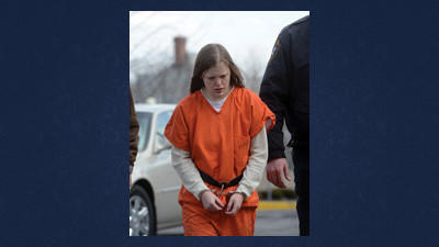 Erin Nicole Everett, who is accused of killing a woman, is escorted to a hearing at the Somerset County Courthouse Tuesday.