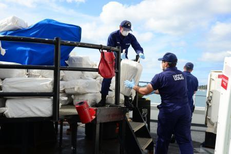 Crew members of the Coast Guard cutter Alert offload more than 3.3 tons of marijuana recovered from the ocean off Southern California. Smugglers threw 245 bales overboard after being spotted about 1:30 a.m. Sunday.