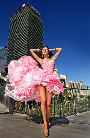 Model Vera Lucherini wears a gown crafted by designer Jennifer Henry. The dress is made primarily of pink tissue paper. Henry will be the artist in residence at the Cosmopolitan later this month.