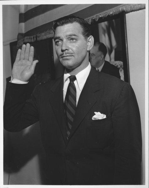 Clark Gable enlists for combat as a private in the Army Air Forces in 1942.