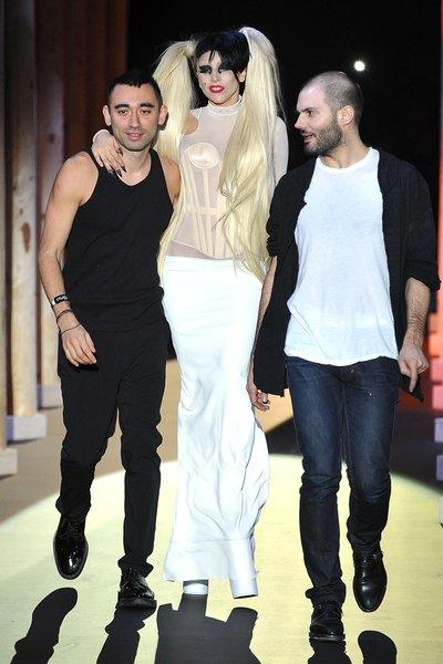 Nicola Formichetti, left, Lady Gaga and Sebastian Peigne (the women's designer at Mugler) walk the runway during the Thierry Mugler ready to wear fall/winter 2011/2012 show during Paris Fashion Week.