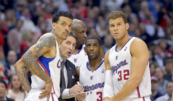 From left, the Clippers' Matt Barnes, Coach Vinny Del Negro, Lamar Odom, Chris Paul and Blake Griffin