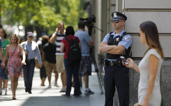 Chicago police officer Zack Sniezek patrols along Michigan Avenue at Chicago Avenue last summer.