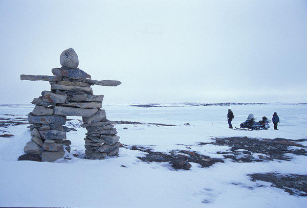 Inukshuks, likenesses of a human form built from unworked stones, are scattered throughout the barren landscape of Canada's Nunavut territory.