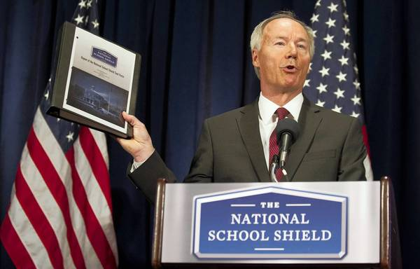 Asa Hutchinson, a former Republican congressman from Arkansas, announces the National School Shield task force findings in a Washington news conference.