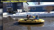 Sam Strange lives in Airport Heights. He says he had a lake in front of his house for two days. The water was deep enough for his two children to row an inflatable raft down the street, and a picture of the kids playing has gone viral on Facebook.