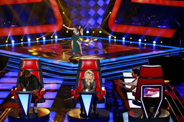 "The blind auditions continue on NBC's ""The Voice."" Judges, in front from left, Usher, Shakira and Adam Levine listen to Agina Alvarez's performance."