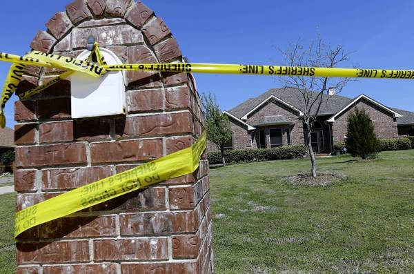 The home of Kaufman County Dist. Atty. Mike McLelland and his wife, Cynthia, was marked off as a crime scene after the couple were slain there.