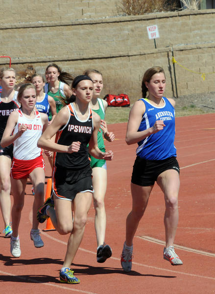 Macy Heinz of Ipswich and Hannah Kastigar leads the way during the 1,600-meter run at the Dakota Clash track and field meet in Pierre. Heinz finished first in the event with a time of 5:12.60. Kastigar placed second in the event.